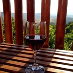 Wine on the deck facing mountains