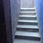 Unpainted, dusty concrete steps leading to our rooms
