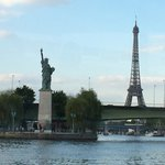 Eiffel Tower and Statue of Liberty side by side. View from the cruise