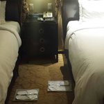 Bed with our nightly mints and slippers laid out for us.  Nice touch