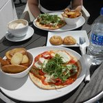 Mozzarella, tomato & pesto flatbread with potato skins. Behind: Mexican chilli & jalapeno flatbr
