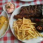 two starters as a main, jerk chicken and chipotle ribs, with extra chips, slaw and cobs.