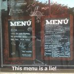 Menu displayed outside Apolo Cafe