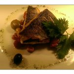 Sea bass fillets with a red onion, olive, chorizo and cherry tomato ragout. ��