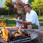 Father Daughter enjoying free s'mores
