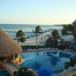 A view from our Ocean front balcony to the right of the hotel, beyond bar, beautiful!