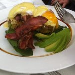 Eggs benedict on low gluten hash cakes with added bacon & avocado