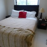 Master bedroom when we arrived, just blanket & no cover on donna, & only 1 lamp LUXURY NOT