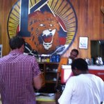 behind the counter roars the Lion of Judah