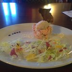 Hot smoked salmon rillet topped with smoked salmon mousse served with a citrus salad
