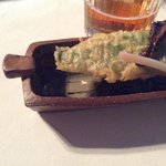 Ramp,morel & wrapped pecorino cheese. served in a Courtney Martin tray.