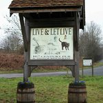 The Live and Let Live Pub sign on the A44