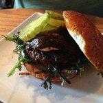 SHORT-RIB BURGER - black garlic bbq, goat cheese, pickles, mustard greens, poppy seed bun