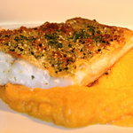 Baked pike-perch filet with sesame-herb crust with caper sauce