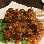 Deep fried Monkey head mushroom on skewer with Satay sauce.  Sauce is very nice. But note that