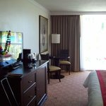 King ocean view room - TV and table w/ chairs
