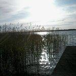 The sun shining on the lake