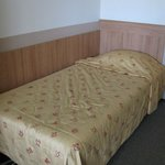 single bed in triple room