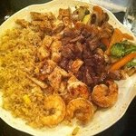 Steak Chicken and Shrimp with Rice and Vegetable .