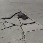 Since 2011 tire-busting pot hole.