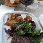 flank steak, roasted potatoes, salad and red wine.