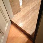 Threshold between bathroom and room.