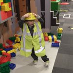 My toddler playing in the giant lego/construction site.