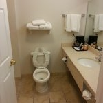 Very clean bathroom with lotion, soap, shampoo, coffee, cups & fresh towles