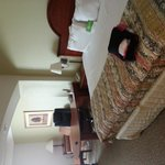 Our bed with a microwave & fridge, sofa, 2 chairs, work desk
