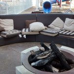 Outdoor seating area with fire pit.