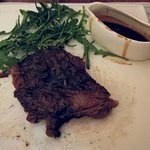 steak with red wine sauce at the side