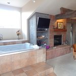Fireplace, tv and tub.