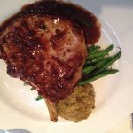 Pork chop with herb stuffing and green beans