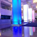 the hotel lobby at day and night