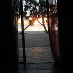 the view with the sunset from your bed