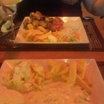 Creamy garlic chicken with rice and chips And Chicken wings with rice chips and salad beautifu