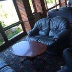 Clamshell sofas, brick columns, bare windows