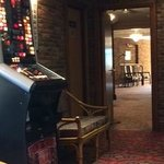 Fruit machine and wicker chairs, evening dining.