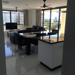 Our very spacious living room with open kitchen and island table! ��