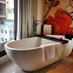 Big Bathtub enough for a couple which can place the champagne glasses and ipad !