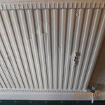 One of the radiators at the top of main staircase