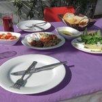 A nice dish of mixed appetizers (mezze) eaten outside in the garden