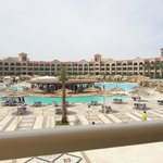 view of main pool/snack bar taken from upper terrace outside reception area / main bar.