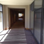 Section of the hallway on the 6th fl with glass panels for spectacular views.