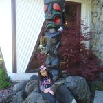 Princess Bella by teh Totem Pole in front of Tiki Resort
