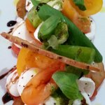 Mixed heritage tomato and mozzarella salad. Fresh and summery.  Mouthwatering delicious light fl