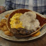 sausage and gravy biscuit and eggs and potatoes