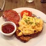 New Zealand style bacon, organic farm grown scrambled eggs on toast with grilled tomato