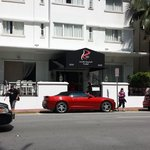 Red Hotel with Red Car out the front