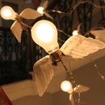 Winged lightbulbs add a touch a whimsy to the stairwell.